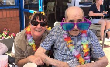 Clarence Court Care Home, Glasgow-Care Assistant Jan and resident James sporting their cool shades