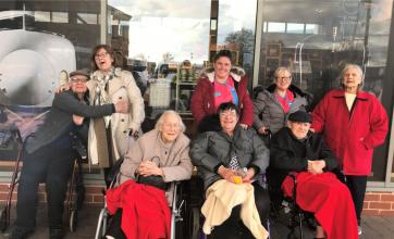 Cookridge Court Care Home, Leeds-All aboard at The National Railway Museum. Back row, residents John and Stella, team members Libby and Amanda and resident Jean. Front, Residents Jean, Lynda and Donald