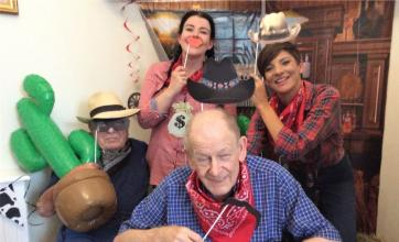 Glebefields Care Home, Banbury-Yee haw! Residents Bert and Alvar with Magic Moments Club team members Nicola and Emily