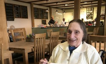 Maureen at the garden centre cafe enjoying coffee and chocolate cake
