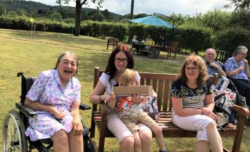 Hempton Field Care Home, Oxfordshire-Resident Elizabeth with her family enjoying our festival in the garden