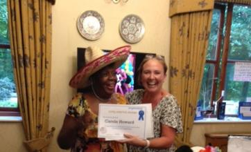 Home Manager Lindsey presenting Nurse Carole Howard with her Long Service Award
