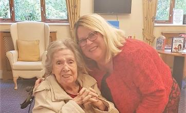 Resident Elsie with her daughter Alison ready for an afternoon of singing