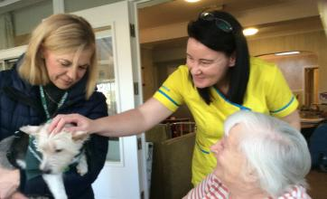 Resident Joyce and Carer Naomi meeting Molly the dog