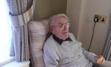 Resident Reginald Weston enjoying his delicious bread with a cuppa