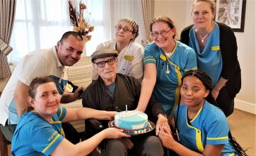 Resident Fredrick celebrating his birthday with team members Bozena, Ioan, Valarie, Lisa, Helen and Naketa