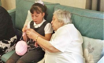 Bamfield Lodge Care Home residents teach local schoolchildren how to knit