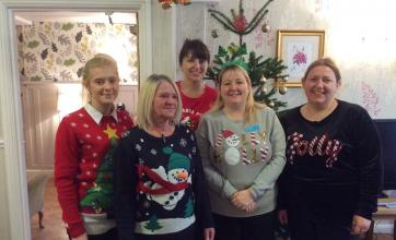 Group photo in our Christmas jumpers