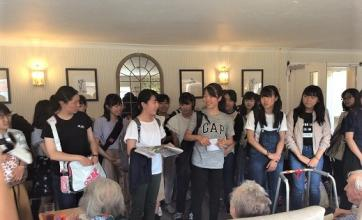 The students performing a song for our residents