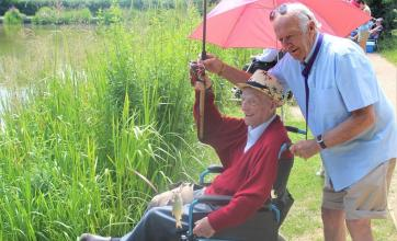 Ivybank House Care Home, Bath-Resident Don lands his first catch with a little help from volunteer Graham