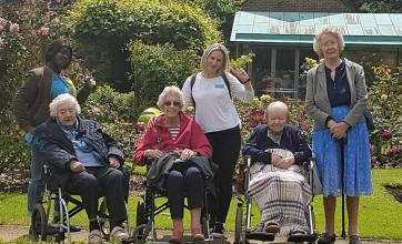 Kingston Care Home, Surrey-Residents and team members enjoying the beautiful walled garden at The Sunbury Embroidery Gallery