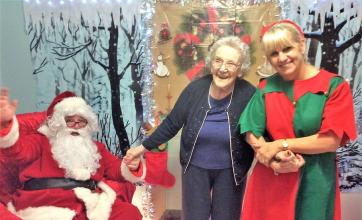 Santa and his elf with our resident Dorothy