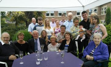 Bert and Mary surrounded by their family in the garden at Leeming Bar Grange