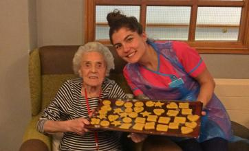 Resident Hilda and Activities Coordinator Mia with the shortbread shapes