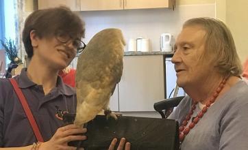 Resident Mirren Gilmour holding an owl