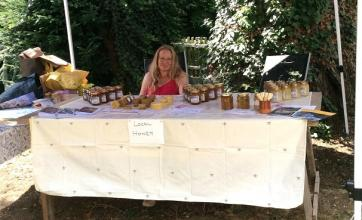 Grace, the daughter of one of our residents manning her honey stall