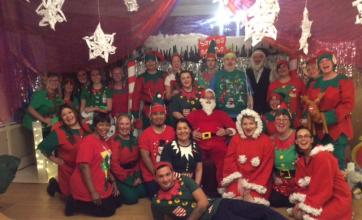 Santa with all his elves in the grotto