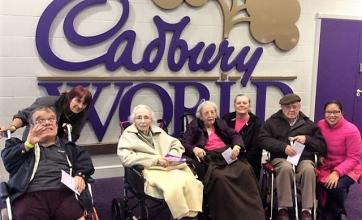 Resident Robert, team member Carol, residents Jean and Julia, team member Katie, resident Frank and team member Yolly about to sample the delights at Cadbury World