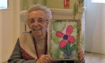 The Granby Care Home, Harrogate-Sylvia proudly holding up her silk painting of a poppy