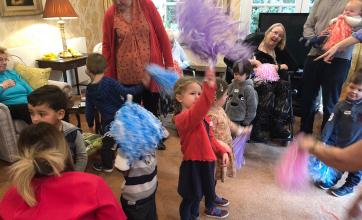 Our residents and the children had great fun shaking their pom poms!