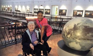 Resident Elizabeth and Magic Moments Club Coordinator Dacia in The World Gallery at the museum