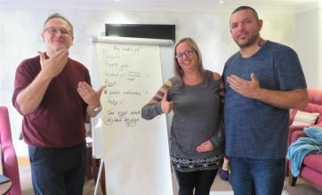 Westbury Court Care Home, Wiltshire-Interpreter Christian, Adrian's wife Linda and team member Adrian teaching us sign language