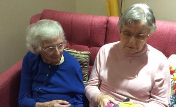 June Emerson & Brenda Trulove examining the gloves