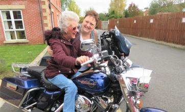 Westbury Court Care Home, Wiltshire-The smile says it all! Cynthia on one of the Harley Davidsons with daughter-in-law Kim