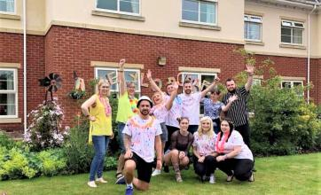Residents and team at Avery Lodge Care Home in Grantham hold a summer colour festival