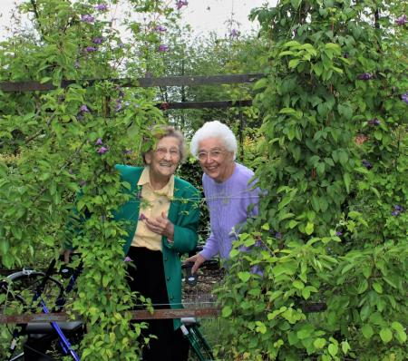 Ashbourne Court Care Home, Andover-Peekaboo! Residents Audrey and Dawn peeping through the archway