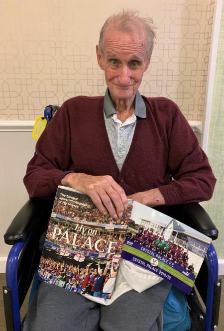 Ashurst Park Care Home, Kent-A thrilled Derek with his Crystal Palace Football Club goodies