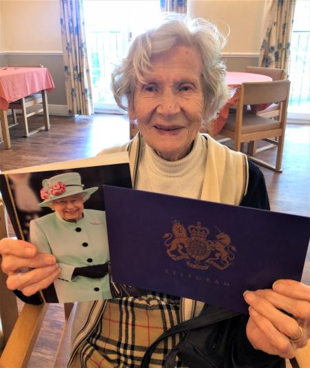 Avery Lodge Care Home, Lincolnshire-A delighted Joan holding her card and telegram from Queen Elizabeth II