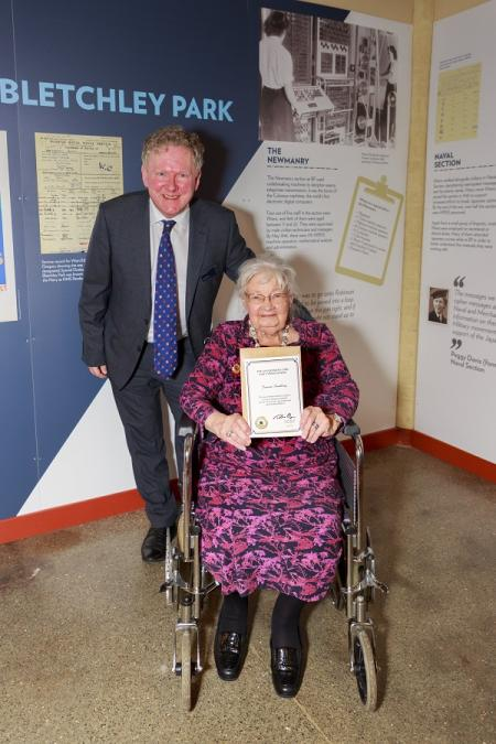 Jonathan Byrne presenting Joanna with a certificate at Bletchley Park