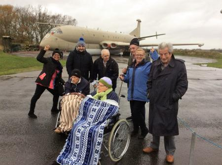 Team members Rose and Ade, residents George and Stephen, team member Suzanne, and residents Richard, Tim and Joyce at The Yorkshire Air Museum