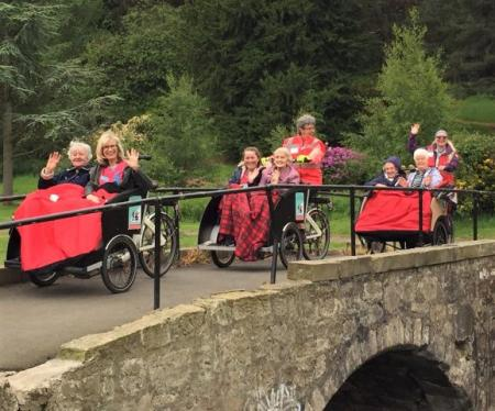 Buchanan Lodge Care Home, Glasgow-Team member Allison, resident Helen, team member Holly, and residents Isobel, Flora and Betty whizzing over the bridge