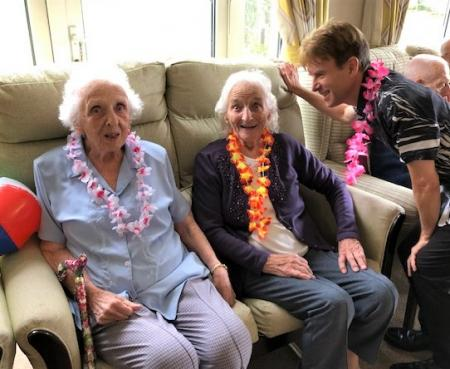 Cossins House Care Home, Surrey-Residents Margaret and Irene having fun with singer Terry