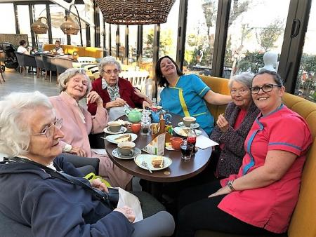 Residents Phyllis, Jean, Kay, Carer Tina, resident Rosina and Magic Moments Club Coordinator Lisa are 'ladies who lunch'!