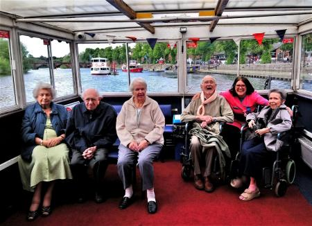 Crabwall Hall Care Home, Chester-All aboard! Residents Audrey, Trevor, Gladys, Bill and Gillian with Magic Moments Club Coordinator Karen sailing along The River Dee