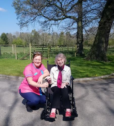 Crabwall Hall Care Home, Cheshire-Magic Moments Club Coordinator Carolyn and resident Daphne having fun in the sun
