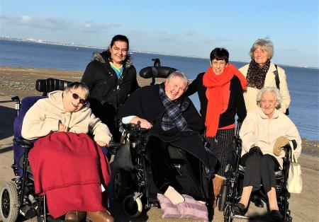 Resident Cathy, Carer Katie, resident Nadia, Carer Becky and residents Eva and Eileen enjoying the views on The Isle of Sheppey