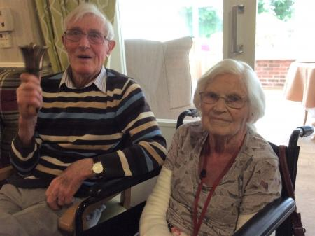 Highfields Care Home, Newark-Family member Bernard has a go at ringing one of the bells, pictured with his wife, resident Hilda