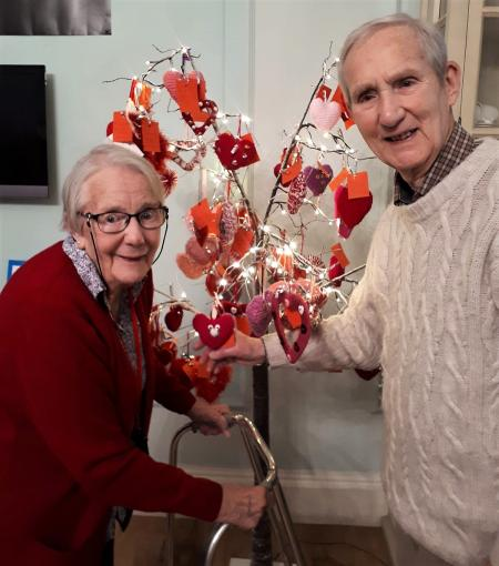 Resident Mavis receives her first ever Valentine from husband Ray