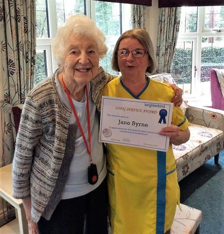 Resident Peggy and Senior Carer Jane with her Long Service Award