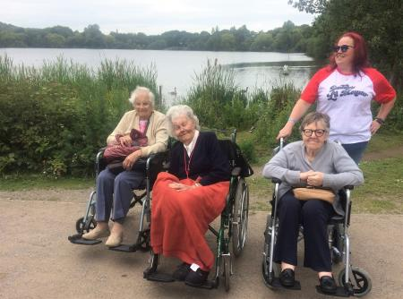 Lawton Manor Care Home, Staffordshire-Residents Alice, Margaret and Samantha with team member Sam enjoying the views at Westport Lake