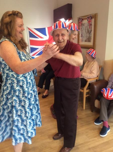 Leeming Bar Grange Care Home-Team member Tracey dancing with resident Jack