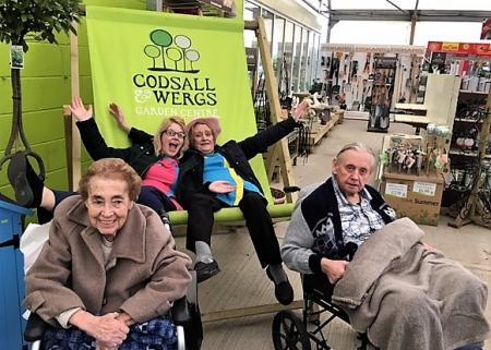 Residents Esme and Ted with team members the two Lauras at our local garden centre