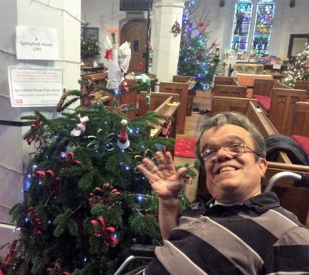 Resident Robert Day at St. Nicholas Church's Christmas Tree Festival