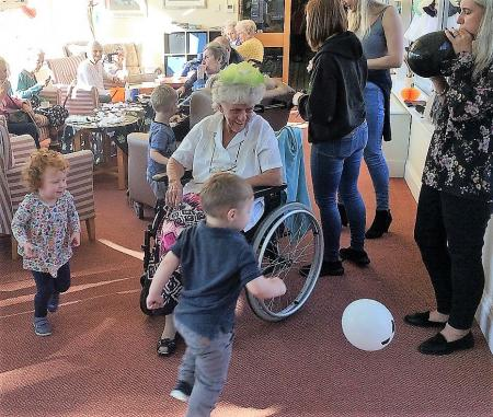 Resident Lil having fun with children from Mucky Munchkins