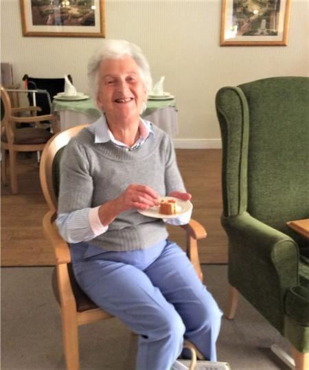 Tewkesbury Fields Care Home, Gloucestershire-Family member Wendy enjoying our harvest bread