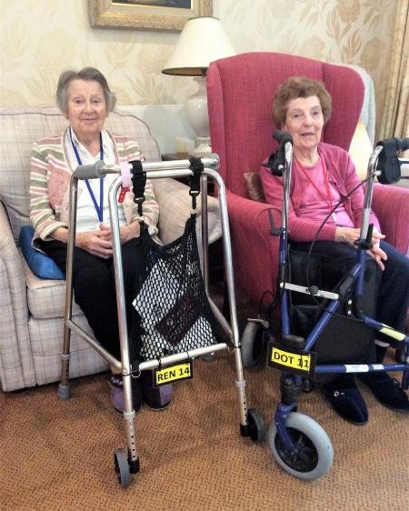 Residents Irene and Dorothy with their personalised walking frames